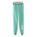 Trendy Number Printed Contrasted Drawstrring Waist Ankle Length Cuffed Carrot-fit Sweatpants in Green