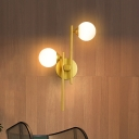 Postmodern Style Ball Sconce Light Ivory Glass 2-Light Living Room Wall Mount Lamp with Rod Arm in Gold