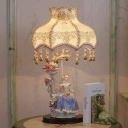 Pastoral Princess On The Swing Night Lamp 1 Head Ceramic Table Light with Flower Fabric Shade in Beige