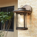 Clear Ripple Glass Cylinder Wall Lamp Traditional 1 Light Outdoor Wall Light Fixture in Bronze