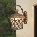 Bronze 1-Light Wall Sconce Lodge Ripple Glass Scrolled Arm Wall Lighting Fixture for Outdoor