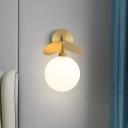Cream Glass Oval/Globe Wall Sconce Minimalism 1 Head Brass Wall Light Fixture with Leaf Decor