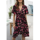 Popular Womens Allover Floral Printed Short Sleeve Surplice Neck Bow Tie Waist Ruffled Trim Midi Pleated A-line Dress in Black