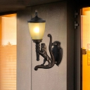 Resin Lion Wall Mount Light Cottage 1-Light Outdoor Wall Lighting Ideas in Dark Coffee with Cone Yellow Glass Shade