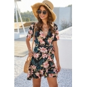 Glamorous Womens Allover Flower Printed Short Sleeve Surplice Neck Bow Tied Waist Ruffled Mini Wrap Dress in Black