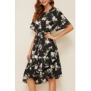 Womens Popular Allover Flower Printed Short Sleeve Round Neck Bow Tied Waist Irregular Fit Mid Pleated A-line Dress in Black