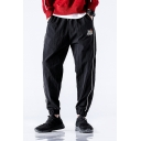 Kpop Mens Letter Flame Graphic Contrast Piped Elastic Waist Cuffed Ankle Tapered-fit Trousers