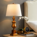 1 Bulb Night Table Lamp with Barrel Shade Fabric Antiqued Bedside Desk Light in Brown