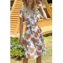 Holiday Girls Allover Floral Print Short Sleeve Surplice Neck Bow Tied Waist Mid Pleated A-line Dress in White