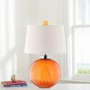 Twisted Glass Orange Night Light Globe 1 Head Postmodern Table Stand Lamp with Tapered Drum Fabric Shade