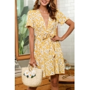 Trendy Womens Allover Floral Print Short Sleeve Deep V-neck Bow Tied Waist Short Pleated A-line Dress in Yellow