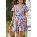 Pretty Womens All over Flower Printed Short Sleeve Surplice Neck Bow Tie Waist Ruffled Short A-line Wrap Dress in Purple