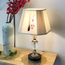 Trapezoid Night Table Light Modernist Plum Blossom Patterned Fabric 1 Light Beige Desk Lamp with Clear Crystal Base