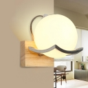 Cream Glass Sphere Wall Sconce Minimalism 1 Light Wall Mount Lighting with Oblong Wood Backplate in White