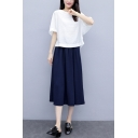 Fashionable Womens Solid Color Half Sleeve Crew Neck Relaxed Fit Blouse Top & Elastic Waist Midi A-Line Skirt Set