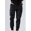 Novelty Mens Drawstring Flap Pocket Cuffed Mid Rise Ankle Length Tapered Cargo Pants in Black