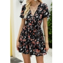 Womens Popular All Over Flower Printed Short Sleeve Surplice Neck Bow Tied Waist Ruffled Hem Short A-line Dress in Black