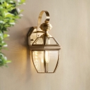 1 Head Wall Lamp Fixture Antiqued Oval/Conical Clear Glass Wall Mount Light with Scroll Arm in Brass