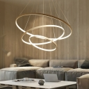 Loop Shaped Metal Pendant Light Fixture Simplicity 3-Head Black/White/Gold LED Chandelier over Table
