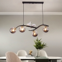 Branch Dining Room Island Pendant Light Smoke Grey/Cognac Ball Glass 4-Bulb Modernist Hanging Lamp in Black/Gold with Bird Decor