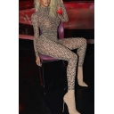 Edgy Girls Allover Letter Print Long Sleeve Mock Neck Ankle Skinny Jumpsuit in Brown