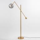 Postmodern 1-Bulb Floor Light Gold/Marble Swing Arm Floor Standing Lamp with Ball Smoke Glass Shade