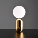 Post-Modern Ball Night Lamp White Glass 1-Light Living Room Small/Large Table Light with Capsule Base in Black/Gold
