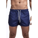 Fancy Men's Shorts Solid Color Drawstring Low Waist Asymmetrical Hem Quick Dry Regular Fitted Shorts