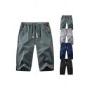 Stylish Men's Shorts Solid Color Pocket Elastic Drawstring Waist Split Hem Regular Fitted Shorts