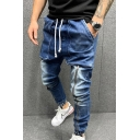 Trendy Men's Jeans Drawstring Bleach Pocket Decorated Zipper Tapered Jeans