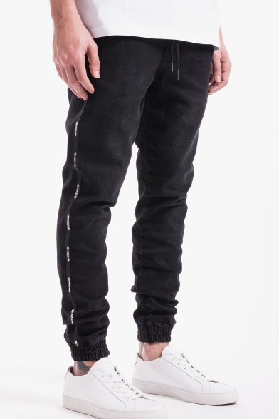 Men's Stylish Graphic Printed Tape Side Zip Embellished Drawstring Waist Elastic Cuffs Black Casual Jeans