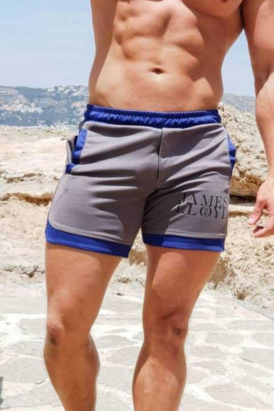Gym Guys Elastic Waist Letter Print Contrast Piped Slim Fit Shorts