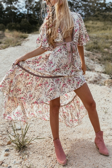 Gorgeous Ladies Bell Sleeve Deep V-Neck Bow Tie Front All Over Flower Print Ruffled Trim Open Back High Low Hem Maxi Flowy Boho Dress in White
