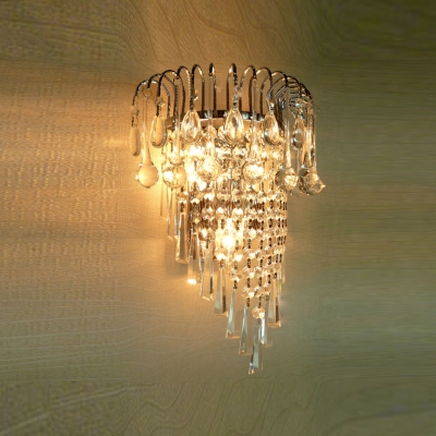 Shimmering Strands of Clear Crystal Hang From Wall Sconce with Graceful Gold Scrolls