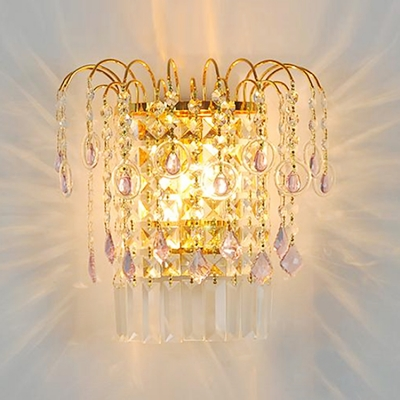 Decadent Wall Sconce Features Gold Finish and Strand of  Crystal Beads