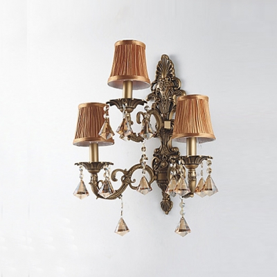 Sophisticates Three Light Wall Sconce Features Wrought Iron Scrolling Arms And Crystal Drops