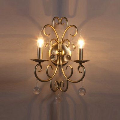 Add  Touch of  Extravagant Luxury with Wall Sconce Features Graceful Scrolls and Clear Crystal Drops