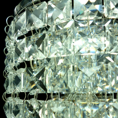 Beautiful Polished Chrome Banding Offers Gleaming Finish for Contemporary Clear Crystal Wall Sconce.