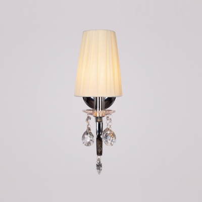 Gleaming Chrome Finish and Crystal Accent Add Glamour to Stunning Single Light Wall Sconce Topped with Beige Fabric Shade