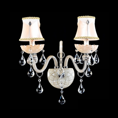 Graceful Scrolling Arms and Crystal Drops Creates Sparkling Wall Sconce