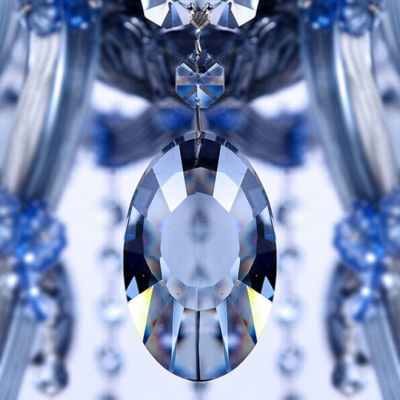 Stunning Silngle Light Wall Sconce Features Hand-cut Crystals and Sleek Blue Finish Body
