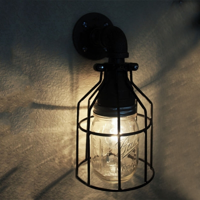industrial wall sconce with metal cage and glass jar shade in black finish