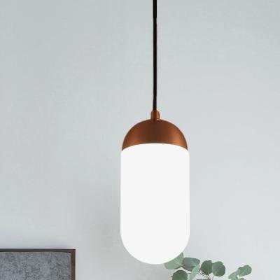 Opal Glass Capsule Pendant Lighting Modern 1-Bulb Hanging Lamp Kit in Copper over Table