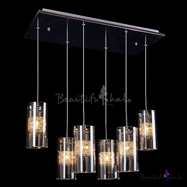 Opulent and modern six light glass cluster chandelier features chic cylinder shades filled clear crystals beautifulhalo com