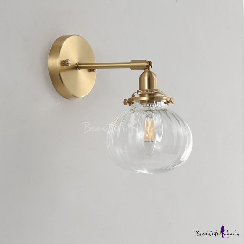 Minimalist Single Wall Light Golden Metal Bent Arm Sconce Lighting Fixture With Champagne Clear Ribbed Glass Globe Shade Beautifulhalo Com